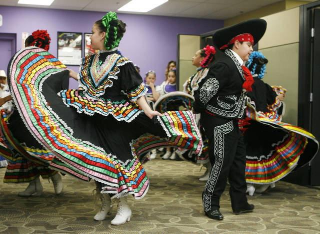 Folkloric dancers from Columbus Elementary School perform a Mexican dance during an opening celebration for the new offices of the Hispanic Chamber of Commerce on SW 59th and Walker in Oklahoma City, OK, Friday, Jan. 30, 2009. BY PAUL HELLSTERN, THE OKLAHOMAN