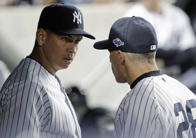 New York Yankees' Alex Rodriguez, left, talks to manager Joe Girardi during the 10th inning of Game 3 against the Baltimore Orioles in the American League division baseball series Wednesday, Oct. 10, 2012, in New York. (AP Photo/Kathy Willens)