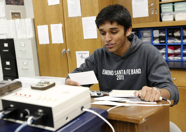 Science bowl team members Steven Kappen reads questions at Edmond Santa Fe High School in Edmond, Okla., Tuesday, March, 6, 2012. Photo by Sarah Phipps, The Oklahoman