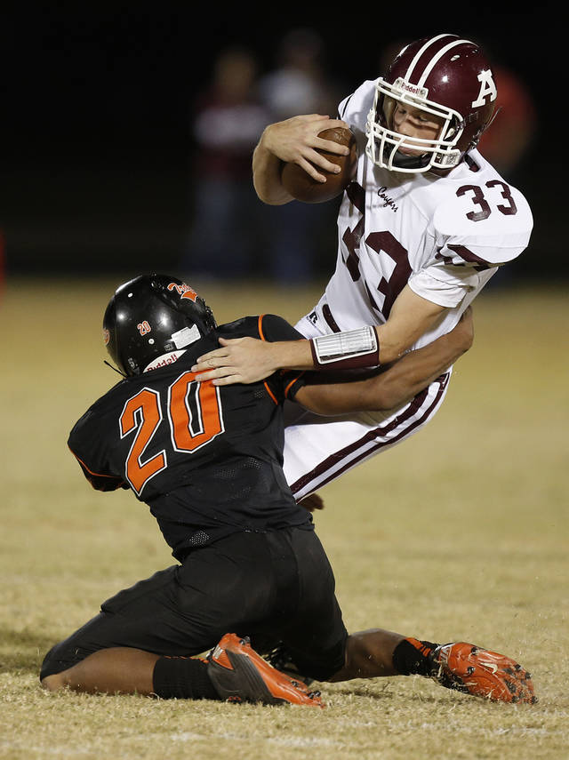 Douglass's Brandon Gaddis (20) takes down Ada's John Stout (33) during a high school football game between Douglass and Ada at Moses F. Miller Stadium in Oklahoma City, Friday, Nov. 2, 2012.  Photo by Garett Fisbeck, The Oklahoman