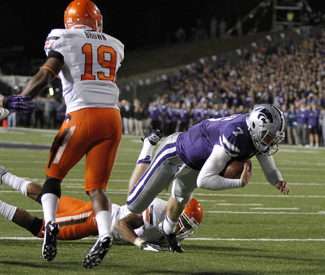 Kansas State's Collin Klein (7) dives for the end zone during the college football game between the Oklahoma State University Cowboys (OSU) and the Kansas State University Wildcats (KSU) at Bill Snyder Family Football Stadium on Saturday, Nov. 1, 2012, in Manhattan, Kan. Photo by Chris Landsberger, The Oklahoman