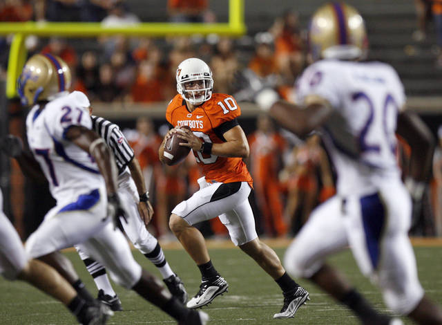 Oklahoma State quarterback Clint Chelf scrambles during the college football game between the University of Tulsa (TU) and Oklahoma State University (OSU) at Boone Pickens Stadium in Stillwater, Oklahoma, Saturday, September 18, 2010. Photo by Sarah Phipps, The Oklahoman