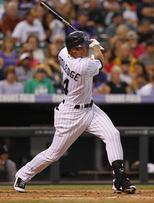 Colorado Rockies' Josh Rutledge follows the flight of his RBI-triple against the Pittsburgh Pirates in the fourth inning of the Pirates' 6-2 victory in a baseball game in Denver on Tuesday, July 17, 2012. (AP Photo/David Zalubowski)