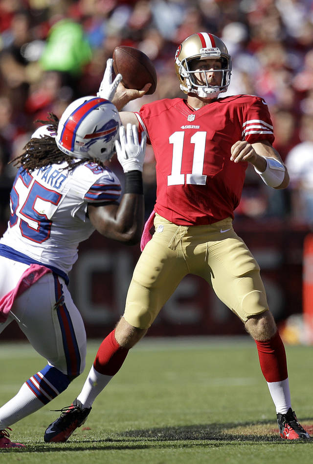 San Francisco 49ers quarterback Alex Smith (11) passes as Buffalo Bills linebacker Kelvin Sheppard (55) applies pressure during the second half of an NFL football game in San Francisco, Sunday, Oct. 7, 2012. The 49ers won 45-3. Smith threw for a season-high 303 yards and three touchdowns. (AP Photo/Ben Margot)