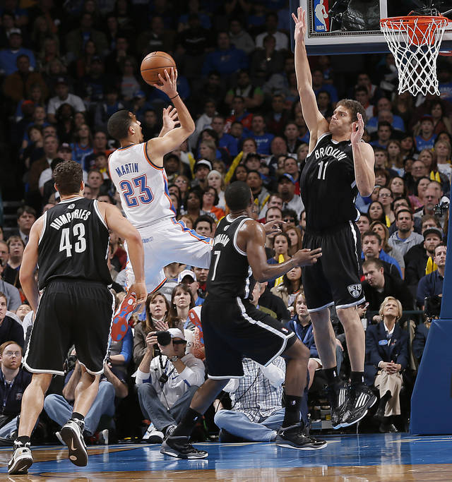 Oklahoma City's Kevin Martin (23) drives against Brooklyn Nets' Kris Humphries (43), Joe Johnson (7) and Brook Lopez (11) during the NBA basketball game between the Oklahoma City Thunder and the Brooklyn Nets at the Chesapeake Energy Arena on Wednesday, Jan. 2, 2013, in Oklahoma City, Okla. Photo by Chris Landsberger, The Oklahoman