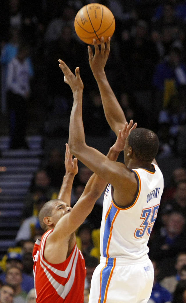 Houston's Shane Battier pressures a shot by Oklahoma City's Kevin Durant during their NBA basketball game at the OKC Arena in downtown Oklahoma City on Wednesday, Nov. 17, 2010. Photo by John Clanton, The Oklahoman