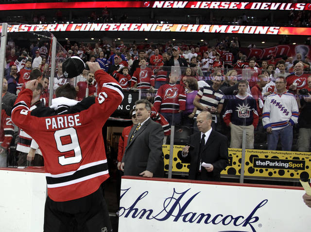 New Jersey Devils' Zach Parise celebrates after the Devils beat the New York Rangers 3-2 in overtime of Game 6 of the NHL hockey Stanley Cup Eastern Conference finals, Friday, May 25, 2012, in Newark, N.J. (AP Photo/Julio Cortez)