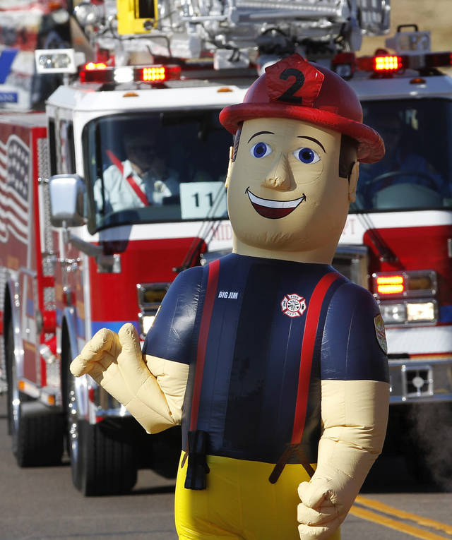 The fire department's inflatable mascot character, Big Jim, walked with the department's delegation in the parade. The city of Midwest City teamed with civic leaders and local merchants to display their appreciation for veterans and active military forces by staging a hour-long Veteran's Day parade that stretched more than a mile and a half along three of the city's busiest streets Monday morning, Nov. 12, 2012. Hundreds of people lined the parade route, many of them waving small American flags that had ben distributed by volunteers who marched near the front of the parade. A fly-over performed by F-16s from the138th Fighter Wing, Oklahoma Air National Guard unit in Tulsa thrilled spectators. Five veterans representing military personnel who served in five wars and military actions served as  Grand Marshals for the parade. Leading the parade was the Naval Reserve seven-story American flag, carried by 100 volunteers from First National Bank of Midwest City, Advantage Bank and the Tinker Federal Credit Union. The flag is 50 feet by 76 feet, weighs 110 pounds and was sponsored by the MWC Chapter of Disabled American Veterans. Photo by Jim Beckel, The Oklahoman