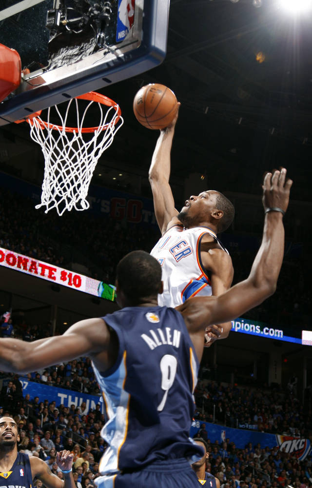 Oklahoma City's Kevin Durant (35) dunks in front of Memphis' Tony Allen (9) during the NBA basketball game between the Oklahoma City Thunder and the Memphis Grizzlies at the Chesapeake Energy Arena in Oklahoma City,  Thursday, Jan. 31, 2013.Photo by Sarah Phipps, The Oklahoman