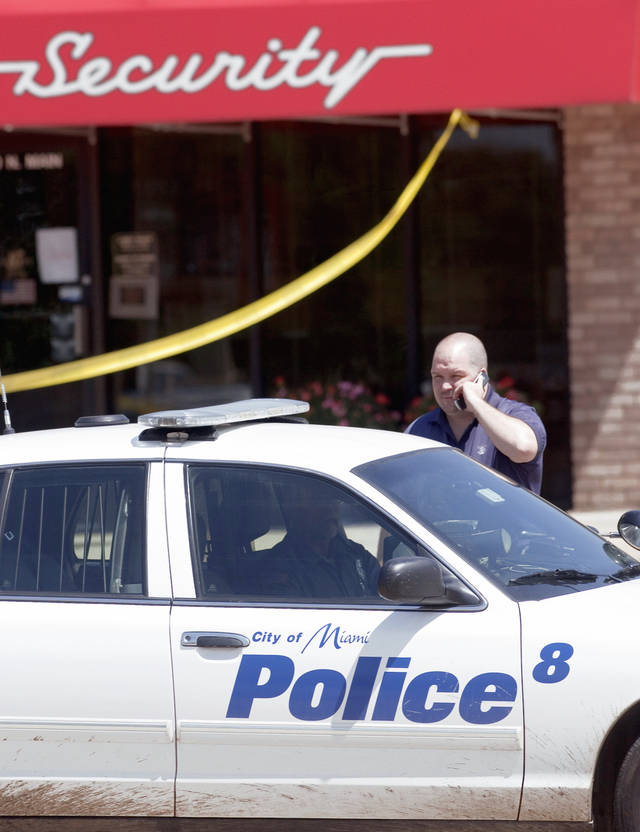 Miami police detective Chris Leamon stands Thursday morning outside the Security Bank and Trust Branch, 2201 N Main in Miami, after it was robbed. Photo by Gary Crow, Tulsa World
