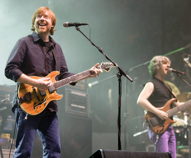 Trey Anastasio, left, and Mike Gordon of Phish will perform at 7 p.m. Wednesday at the Zoo Amphitheatre, 2101 NE 50. For tickets, go to zooamp.com. For information, call 364-3700. AP PHOTO