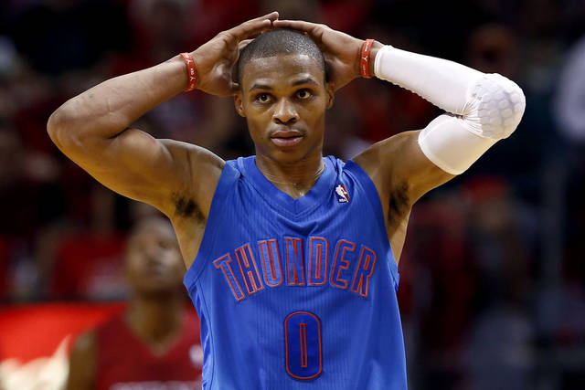 Oklahoma City Thunder's Russell Westbrook reacts during the final minute of an NBA basketball game against the Miami Heat in Miami, Tuesday, Dec. 25, 2012. The Heat won 103-97. (AP Photo/J Pat Carter) ORG XMIT: FLJC122