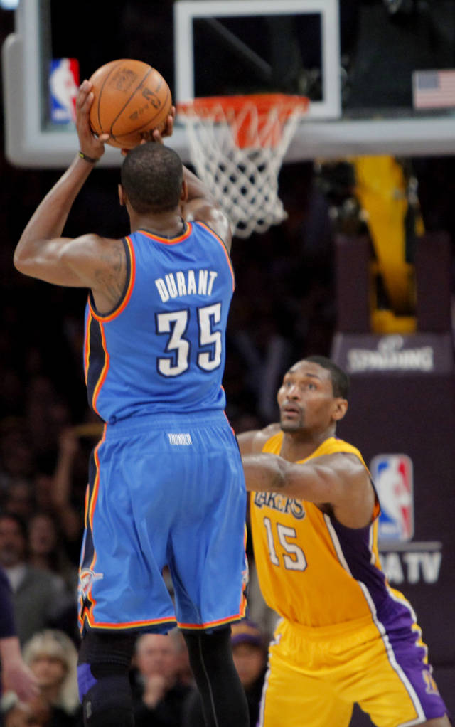 Oklahoma City's Kevin Durant (35) shoot the game winning three-point shot over Los Angeles' Metta World Peace (15) during Game 4 in the second round of the NBA basketball playoffs between the L.A. Lakers and the Oklahoma City Thunder at the Staples Center in Los Angeles, Saturday, May 19, 2012. Oklahoma City won, 103-100. Photo by Nate Billings, The Oklahoman