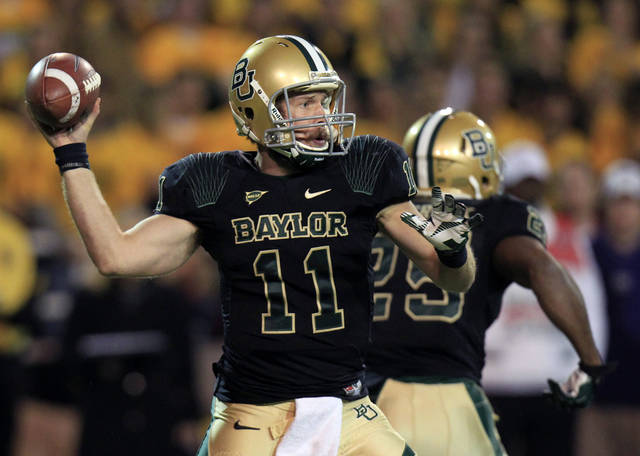 Baylor quarterback Nick Florence (11) throws during the first quarter of the NCAA college football game against Kansas State on Saturday, Nov. 17, 2012, in Waco, Texas. (AP Photo/LM Otero)