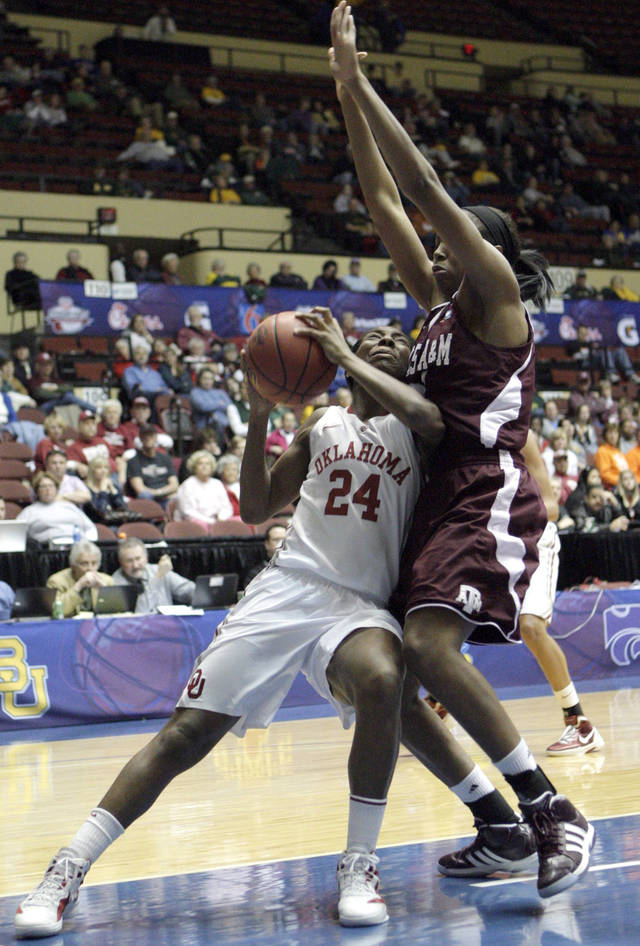 Oklahoma's Sharane Campbell (24) tries to shoot around Texas A&M's Adaora Elonu (21) during the Big 12 tournament women's college basketball game between the University of Oklahoma Sooners and the Texas A&M Aggies at Municipal Auditorium in Kansas City, Mo., Friday, March 9, 2012. Photo by Sarah Phipps, The Oklahoman.