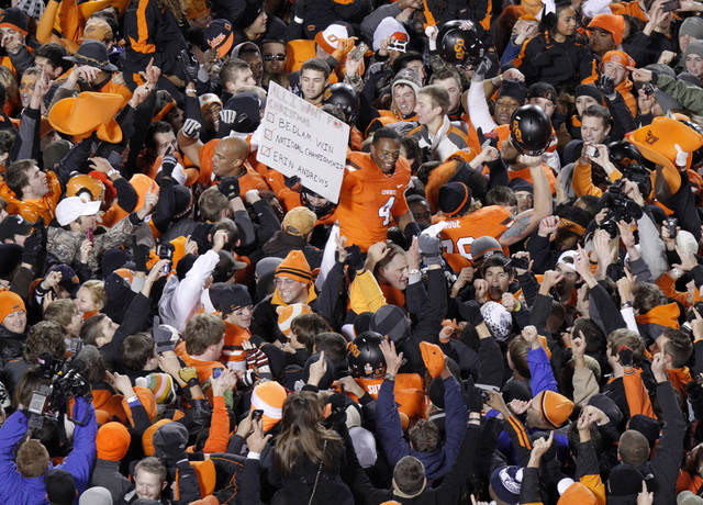 Oklahoma State's Justin Gilbert (4) celebrates with fans during the Bedlam college football game between the Oklahoma State University Cowboys (OSU) and the University of Oklahoma Sooners (OU) at Boone Pickens Stadium in Stillwater, Okla., Saturday, Dec. 3, 2011. Photo by Bryan Terry, The Oklahoman