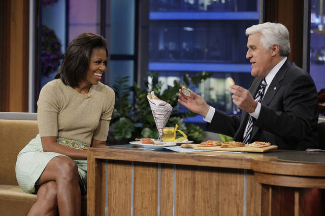 "FILE - In this Jan. 31, 2012 file image originally released by NBC shows first lady Michelle Obama speaking with host Jay Leno during an appearance on ""The Tonight Show with Jay Leno,"" in Burbank, Calif. NBC announced Monday, Aug. 6, that the first lady will make her third appearance on ""The Tonight Show"" on Aug. 13 to talk about the London Olympics and life with President Barack Obama and their children at the White House. On her last stopover in January, the first lady promoted her ""Let's Move!"" campaign to get kids excited about fitness and healthy eating habits. (AP Photo/NBC, Stacie McChesney, file)"