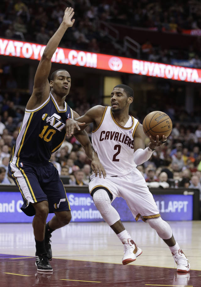 Cleveland Cavaliers' Kyrie Irving (2) drives against Utah Jazz's Alec Burks (10) during the fourth quarter of an NBA basketball game Wednesday, March 6, 2013, in Cleveland. The Cavaliers won 104-101. (AP Photo/Tony Dejak)