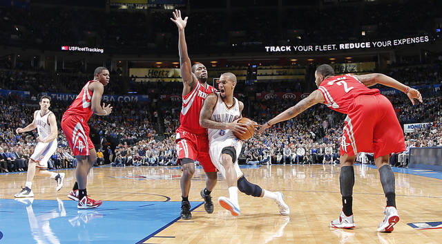 Oklahoma City 's Eric Maynor (6) drives through the Houston defense during the NBA basketball game between the Houston Rockets and the Oklahoma City Thunder at the Chesapeake Energy Arena on Wednesday, Nov. 28, 2012, in Oklahoma City, Okla.   Photo by Chris Landsberger, The Oklahoman