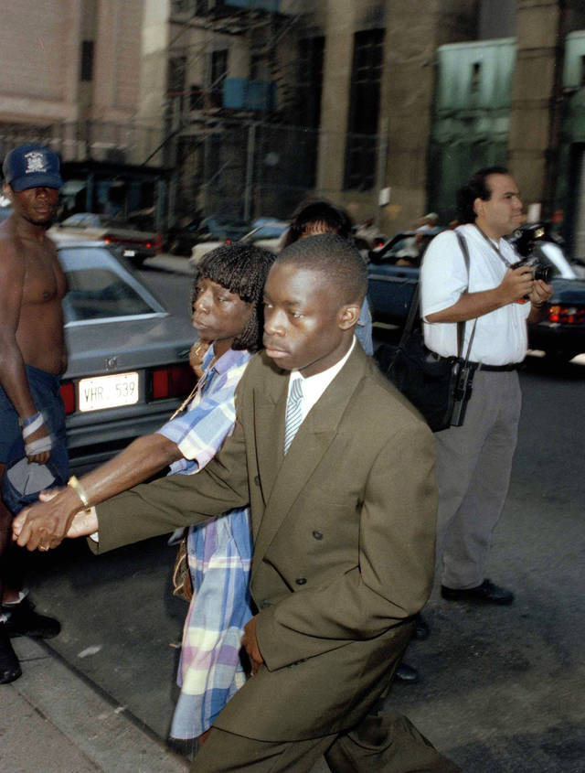FILE - In this Aug. 14, 1990 file photo, Antron McCray arrives with his mother, Linda, for court in connection with the Central Park jogger trial in New York. McCray and four other teenage boys maintained their innocence as they grew up behind bars after being convicted in the rape and brutal beating of the woman jogger. Their convictions were eventually tossed out by a judge when new evidence surfaced linking someone else to the crime. But their legal battle goes on: A $250 million federal lawsuit against police and prosecutors has been pending nearly a decade, with no resolution in sight.  (AP Photo/Malcolm Clarke, File)