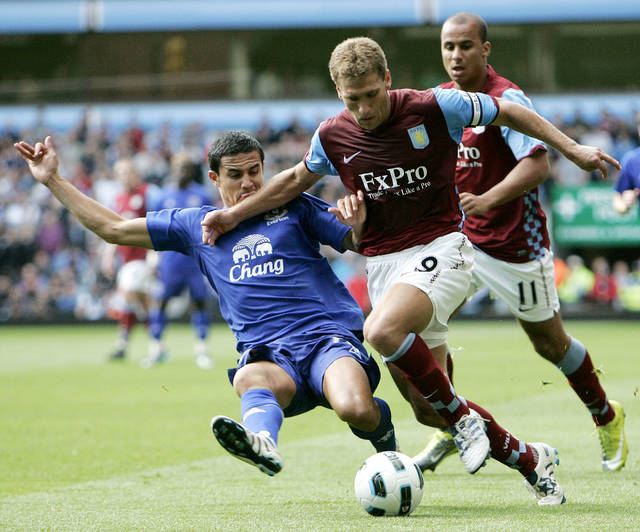 FILE - This is a Sunday, Aug. 29, 2010 file photo of Aston Villa's Stiliyan Petrov, right, and Everton's Tim Cahill vie for the ball during their English Premier League soccer match at Villa Park in Birmingham, England. Aston Villa said Friday March 30, 2012. club captain Stiliyan Petrov has been diagnosed with acute leukemia. (AP Photo/Akira Suemori, File)