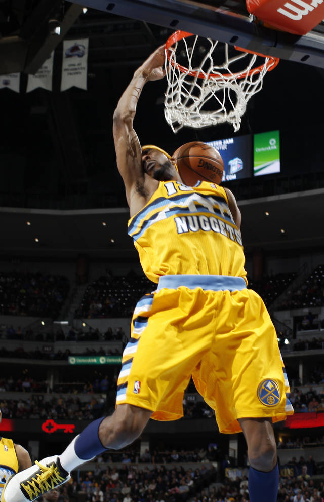 Denver Nuggets forward Corey Brewer dunks for a basket against the Charlotte Bobcats in the third quarter of the Nuggets' 110-88 victory in an NBA basketball game in Denver, Saturday, Dec. 22, 2012. (AP Photo/David Zalubowski)