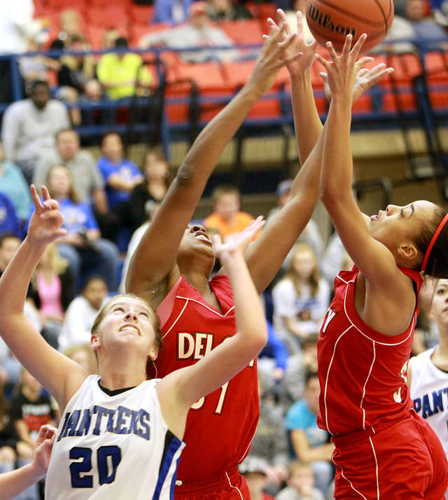 Del City's Jakeyma Williams and Shafaun Jones (right) get a rebound over Harrah's Jordon Hobbs during their game at the Harrah Panther Classic at Harrah High School in Harrah Oklahoma on Friday, Dec. 10, 2010. Photo by John Clanton, The Oklahoman