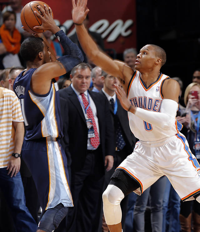Oklahoma City's Russell Westbrook (0)  defends on Memphis' Mike Conley Jr. (11) during the NBA basketball game between the Oklahoma City Thunder and the Memphis Grizzlies at Chesapeake Energy Arena on Wednesday, Nov. 14, 2012, in Oklahoma City, Okla.   Photo by Chris Landsberger, The Oklahoman