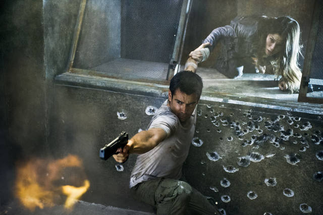 "This film image released by Columbia Pictures shows Jessica Biel, right, and Colin Farrell in a scene from the action thriller ""Total Recall.""  (AP Photo/Columbia Pictures - Sony, Michael Gibson) ORG XMIT: NYET715"