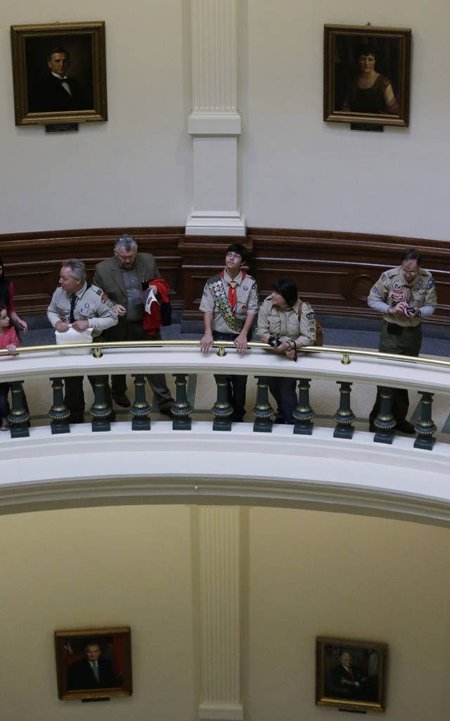 Boy Scouts are seen in the rotunda of the Texas State Capitol as they wait to hear Gov. Rick Perry speak during the annual Boy Scouts Parade and Report to State, Saturday, Feb. 2, 2013, in Austin, Texas. Perry says he hopes the Boy Scouts of America doesn't move soften its mandatory no-gays membership policy. (AP Photo/Eric Gay)