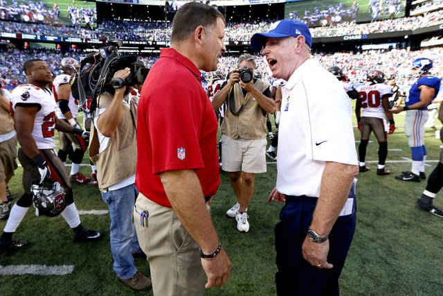 Tampa Bay Buccaneers head coach Greg Schiano, left, and New York Giants head coach Tom Coughlin exchange words at the end of an NFL football game Sunday, Sept. 16, 2012, in East Rutherford, N.J. The Giants won the game 41-34. (AP Photo/Julio Cortez) ORG XMIT: NY110