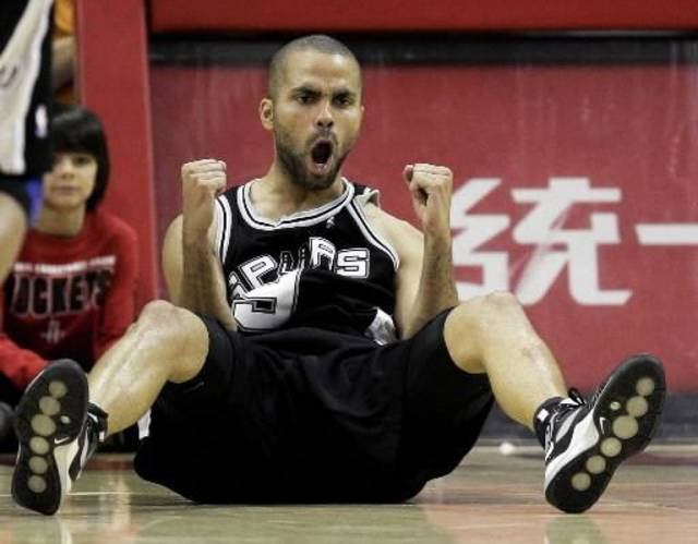 This March 14, 2009 file photo shows San Antonio Spurs'  Tony  Parker, of France, reacting after making a basket as he was fouled during the closing minutes of the fourth quarter of an NBA basketball game against the Houston Rockets in Houston.  Parker will miss about six weeks with a broken right hand. The team said Monday March 8, 2010 that  Parker won't need surgery, meaning he may be able to return later this season. Tests show he fractured the fourth metacarpal in his shooting hand Saturday during a victory at Memphis. (AP Photo/David J. Phillip,File)