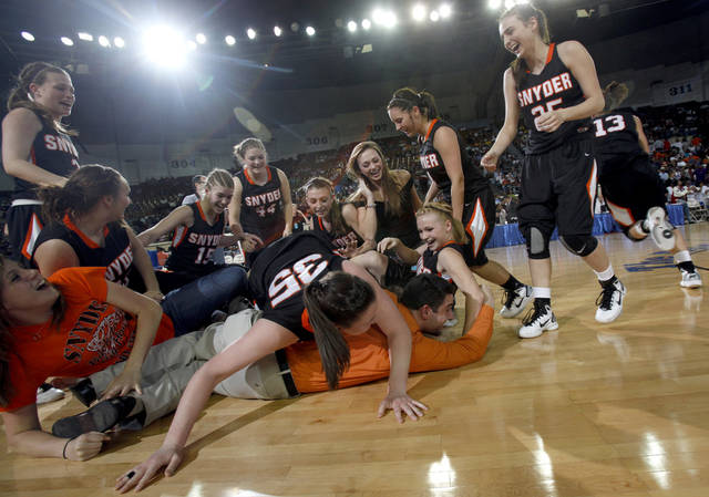 Snyder celebrates their win over Millwood during the 2a girls state championship game, Saturday, March, 12, 2011, at the the State Fair Arena. Okla. Photo by Sarah Phipps, The Oklahoman.