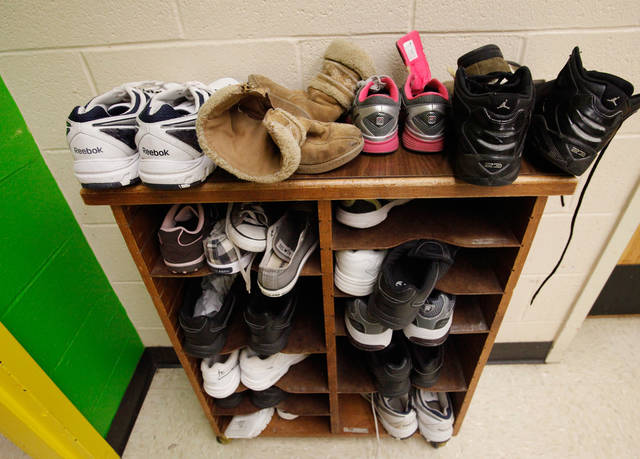 Shoes for children of a variety of ages are shown on a rack during a tour of the Pauline E. Mayer Children's Shelter in Oklahoma City, on Monday,  Jan. 23, 2012.   Photo by Jim Beckel, The Oklahoman