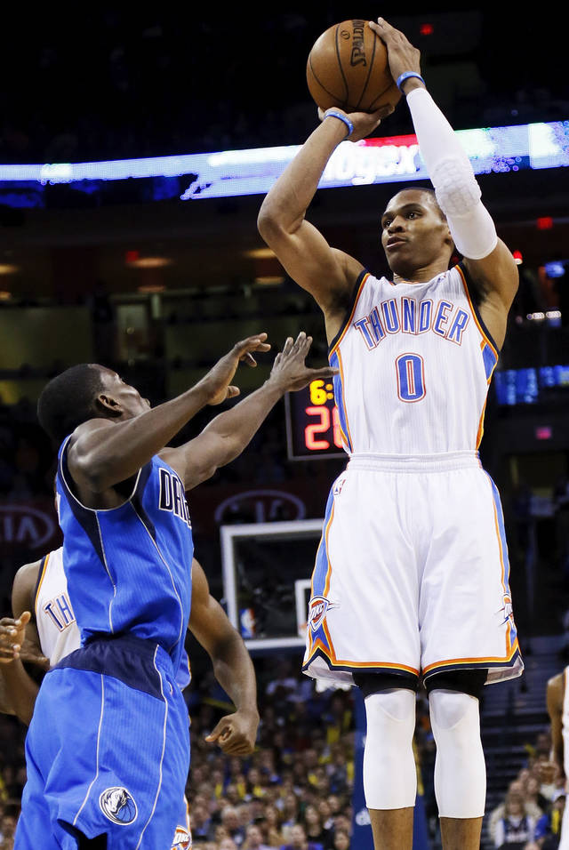 Oklahoma City's Russell Westbrook (0) shoots over Dallas' Darren Collison (4) during an NBA basketball game between the Oklahoma City Thunder and the Dallas Mavericks at Chesapeake Energy Arena in Oklahoma City, Monday, Feb. 4, 2013. Photo by Nate Billings, The Oklahoman