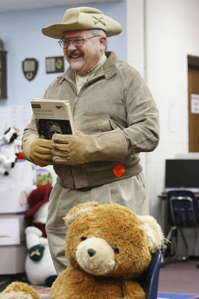 Bob Nance, Teddy Roosevelt re-enactor, talks with Houchin Elementary School second-graders before a teddy bear giveaway  in Moore, Tuesday December,20,  2011. Photo by Steve Gooch, The Oklahoman