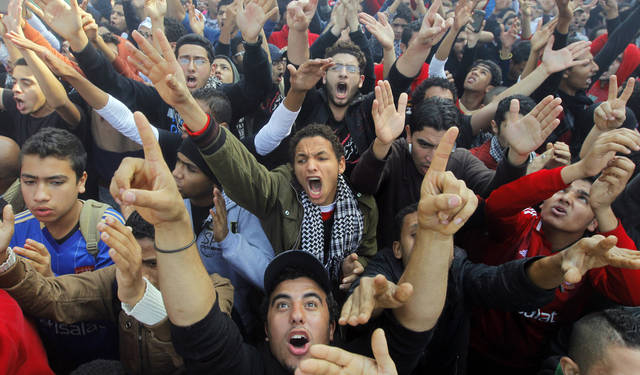 UPDATES DEATH TOLL - Egyptian soccer fans of Al-Ahly club celebrate a court verdict that returned 21 death penalties in last years soccer violence, inside the club premises in Cairo, Egypt, Saturday, Jan. 26, 2013. Egyptian security officials say that 38 people have died in the Mediterranean city of Port Said after a judge sentenced 21 people to death in connection to one of the world's deadliest incidents of soccer violence. (AP Photo/Amr Nabil)