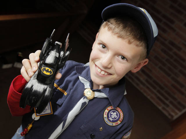 Cub Scout Matthew Rapson, 8, poses for a photo with his pinewood derby car in Nicoma Park, Okla., Thursday, Feb. 16, 2012. Photo by Nate Billings, The Oklahoman