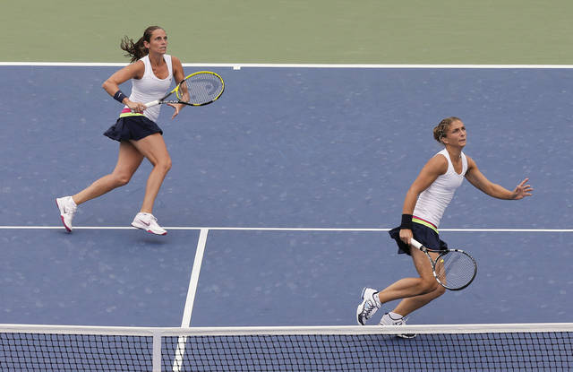 Italy's Roberta Vinci, left, and Sara Errani chase after a lob shot while playing Nuria Llagostera Vives and Maria Jose Martinez Sanchez during the women's doubles semifinals of the 2012 US Open tennis tournament, Thursday, Sept. 6, 2012, in New York. (AP Photo/Julie Jacobson)