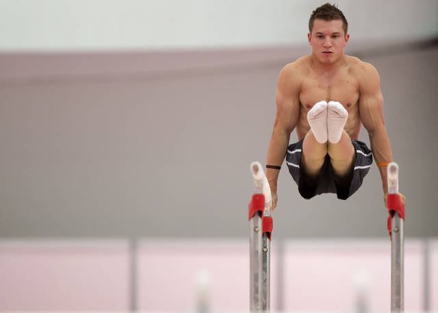 U.S. gymnast Jonathan Horton, a former Oklahoma standout, warms up on the parallel bars during practice for the Olympics on Tuesday in London. Horton is one of five current and former Sooners on the team. The others are Chris Brooks, Jake Dalton, Steve Legendre and Alex Naddour, AP Photo