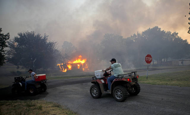 Residents bring water to firefighters in Luther, Okla., after wildfire moved through the area on Friday, August 3, 2012. Photo by Bryan Terry, The Oklahoman