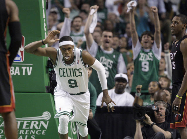Boston Celtics guard Rajon Rondo (9) reacts in front of Miami Heat guard Mario Chalmers, right, after sinking a basket during the third quarter of Game 3 in the NBA basketball playoffs Eastern Conference finals, in Boston on Friday, June 1, 2012. (AP Photo/Elise Amendola)