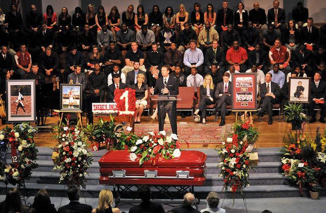"""As the Oklahoma football team listens, head football coach Bob Stoops explains how important Austin Box was to the success of the Oklahoma Sooners and to the community of Enid, Okla., Friday, May 27, 2011, during a """"Celebration of Life"""" at Emmanuel Baptist Church. Box, a three-year letterman in football for the Sooners, passed away May 19 in Oklahoma City. (AP Photo/Enid News and Eagle, Bonnie Vculek) ORG XMIT: OKENI102"""