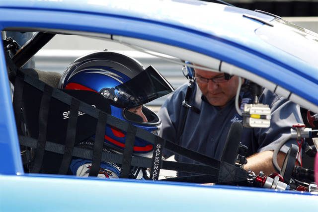 "In this photo taken Friday, July 22, 2011, actor and race car driver Patrick Dempsey sits in his Mazda race car in the pits at New Jersey Motorsports Park in Millville, N.J., during practice for Sunday's Grand Am race. Dempsey, who plays Dr. Derek Shepherd in the popular television show ""Grey's Anatomy"", is a regular on the Grand Touring Class. (AP Photo/Mel Evans)"