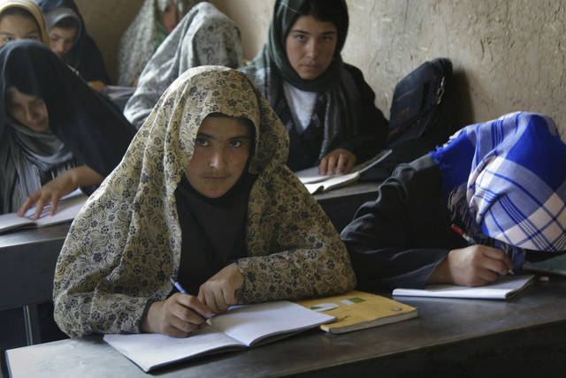 In this June 4, 2011 photo, women attend a literacy class at the Afghan Institute of Learning in Anjil, Herat province, west of Kabul, Afghanistan. Sakena Yacoobi's AIL has grown from a few makeshift schools in Pakistan and Afghanistan in the mid-1990s to an organization running schools, women's learning centers, day care centers and clinics across seven of the 34 Afghan provinces. (AP Photo)