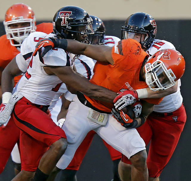 Texas Tech's D.J. Johnson (12) and Cody Davis (16) stop Oklahoma State's Joseph Randle (1) during the college football game between the Oklahoma State University Cowboys (OSU) and Texas Tech University Red Raiders (TTU) at Boone Pickens Stadium on Saturday, Nov. 17, 2012, in Stillwater, Okla.   Photo by Chris Landsberger, The Oklahoman