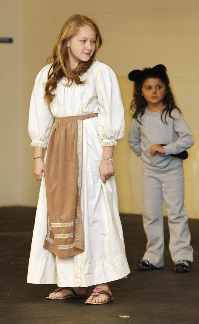 "Fourth-grader Asher Bartlett,  9,  performs as Cinderella in the play ""Cinderella"" at John Glenn Elementary School. Photo by Paul B. Southerland, The Oklahoman <strong>PAUL B. SOUTHERLAND - PAUL B. SOUTHERLAND</strong>"