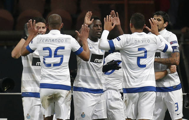FC Porto players celebrate their goal against Paris Saint-Germain during their Champions League soccer match at the Parc des Princes stadium, in Paris, Tuesday, Dec. 4, 2012. (AP Photo/Christophe Ena)