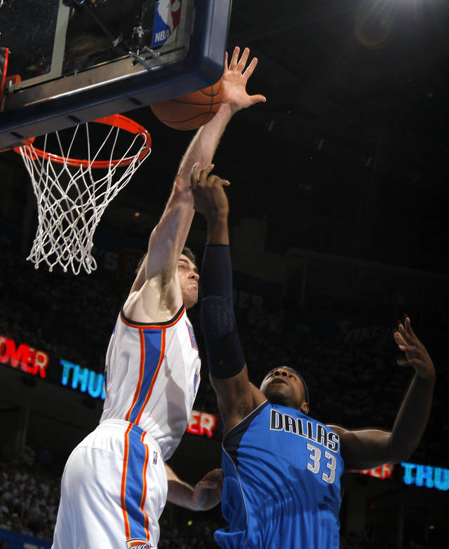 Oklahoma City's Nick Collison (4) defends against Dallas' Brendan Haywood (33) during Game 2 of the first round in the NBA basketball playoffs between the Oklahoma City Thunder and the Dallas Mavericks at Chesapeake Energy Arena in Oklahoma City, Monday, April 30, 2012. Photo by Sarah Phipps, The Oklahoman