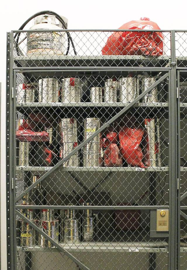 A cage at the Oklahoma City Fire Prevention Center holds evidence from fire investigations.  Photo by TIFFANY GIBSON, The Oklahoman